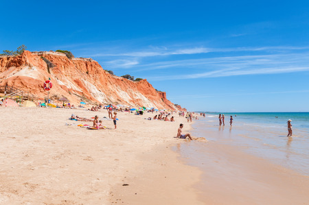 region of algarve: ALBUFEIRA, PORTUGAL - AUGUST 30, 2014: Crowded Falesia Beach seen from the cliff. This beach is a part of famous tourist region Algarve. Editorial