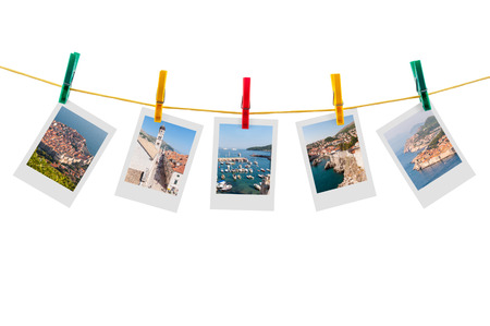Five photos of Dubrovnik on clothesline isolated on white background with clipping path photo