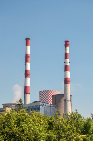 contaminate: Cooling tower and chimneys of coal power plant.