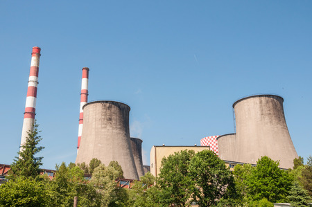 condensers: Cooling tower and chimneys of coal power plant.