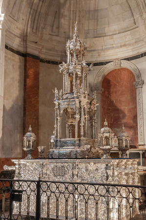 liturgical: CADIZ, SPAIN - AUGUST 27, 2014: Custodia del Millon, a 17th Century four meter tall silver monstrance set with a million precious gemstones in the Cadiz Cathedral,