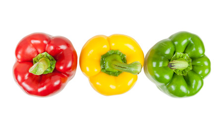 Top view of  three colored peppers isolated on white background with clipping path