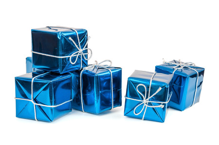 Group of blue gift boxes with silver ribbons isolated on white background with clipping path