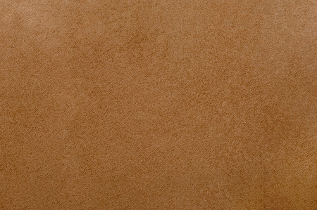 Brown colored leather texture as abstract background