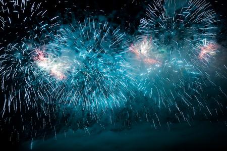 glow pyrotechnics: Blue purple fireworks on the night sky