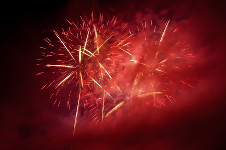 red sky: Beautiful red fireworks on the night sky