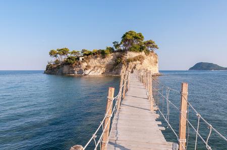 Greece: Hanging wooden bridge to Cameo Island, Zakynthos, Greece Stock Photo