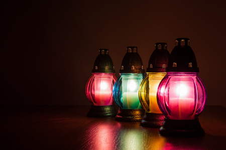 bereavement: Closeup of burning votive candles in the dark Stock Photo
