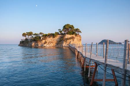 cameo: Hanging wooden bridge to Cameo Island at sunset, Zakynthos, Greece