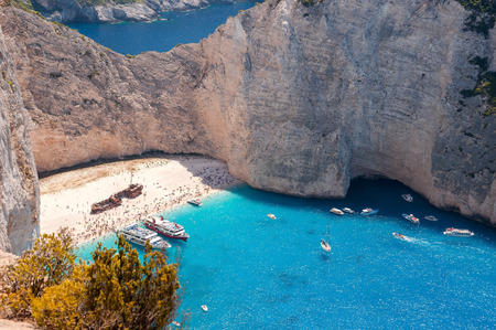 Crowded Navagio Beach on Zakynthos seen from the cliff