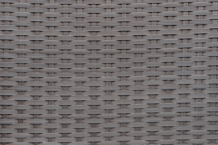 woven: Background or texture made of woven plastic wicker pattern