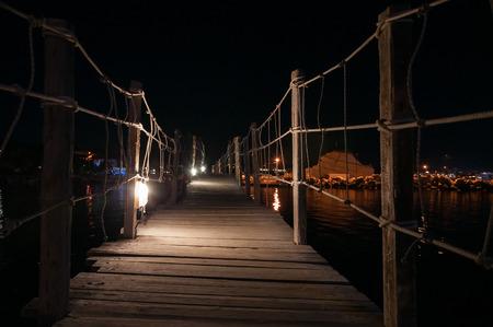 cameo: Hanging wooden bridge to Cameo Island at night, Zakynthos, Greece Stock Photo