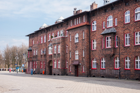 old mining building: Katowice, Poland - March 28, 2016: Nikiszowiec, historic district of Katowice. Initially it was coal miners settlement of Giesche mine.