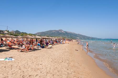 mediteranean: Banana beach, Zakynthos, Greece - August 31, 2015: People sunbathe on the Banana beach, one of the most famous beaches on Zakynthos Island.