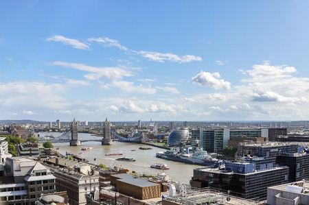 hms: Aerial view of River Thames in London including Tower Bridge, City Hall and HMS Belfast Stock Photo