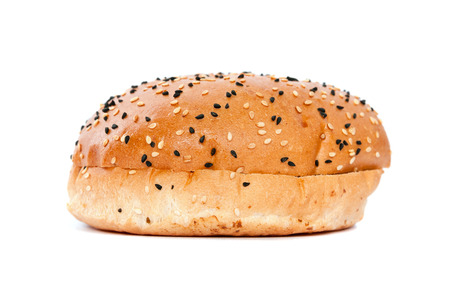 Burger bun with sesame seeds isolated on white background