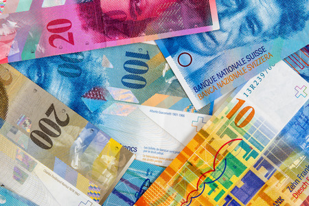 swiss franc: Business background made of swiss franc banknotes