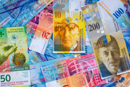 swiss franc note: Business background made of swiss franc banknotes