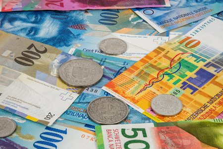 swiss franc note: Business background made of swiss franc and coins