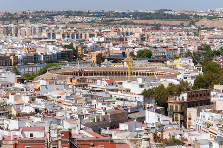 bullfight: Rooftop view of Seville city in Spain from the Giralda tower with the bullfight arena