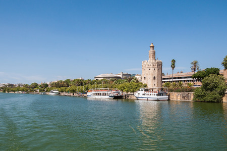 seville: Torre del Oro (Tower of Gold) seen from the Guadalquivir River in Seville, Spain