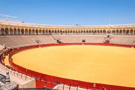 plaza de toros: Seville, Spain - August 28, 2014: Empty bullfight arena called Plaza de toros de la Real Maestranza de Caballeria de Sevilla