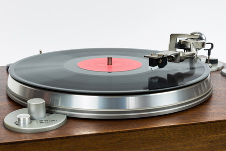counterweight: Closeup of turntable with vinyl record on white background