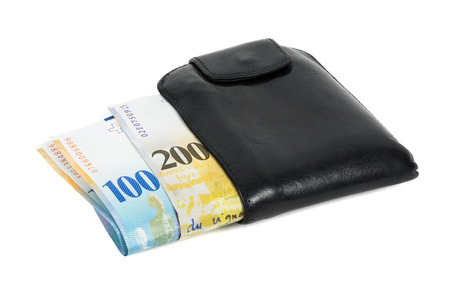 franc: Swiss franc banknotes in black wallet isolated on white background with clipping path