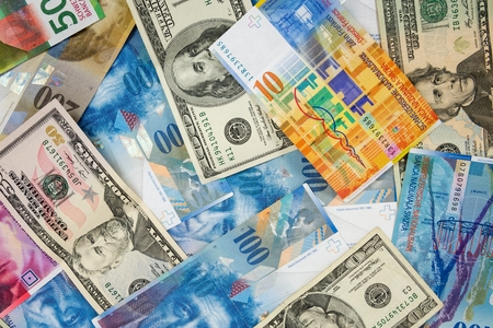 swiss franc note: Background made of dollar and swiss franc banknotes