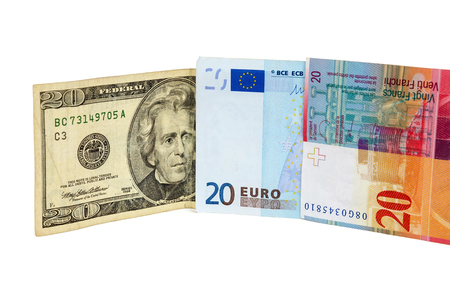 swiss franc note: Banknotes of 20 dollars, euro and swiss franc isolated on white background
