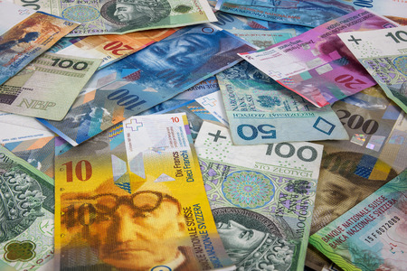 zloty: Background made of polish zloty and swiss franc banknotes