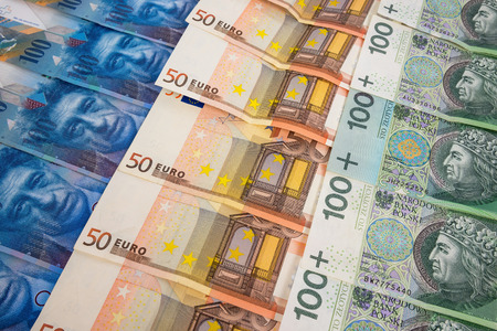 swiss franc note: PLN EURO and CHF banknotes laying in a rows