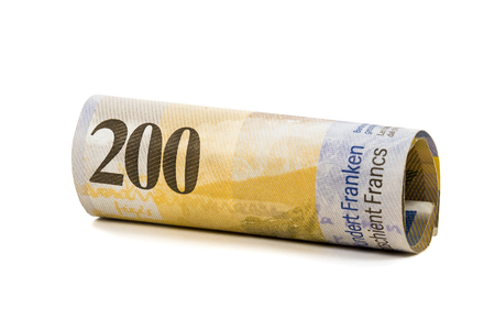 swiss franc note: Rolled 200 swiss francs banknotes isolated on white background