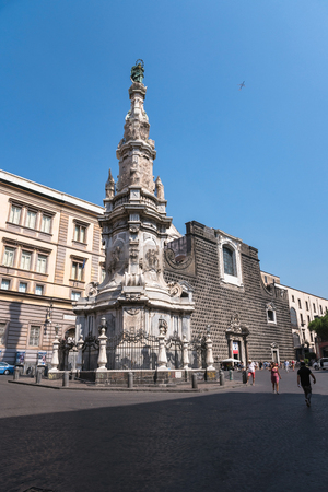 immaculate: naples, Italy - August 30, 2016: New Jesus square with the monument called The Spire of the Immaculate Virgin.