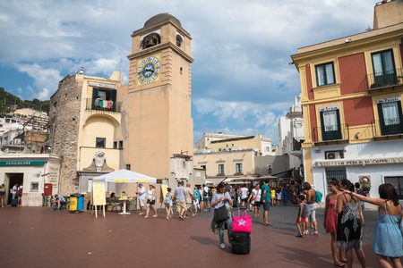 Capri, Italy - August 31, 2016: Tourists visit Piazza Umberto I, the most famous square of the island of Capri.