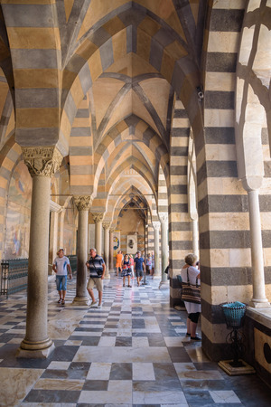 Amalfi, Italy - September 1, 2016: Tourists visit a 9th-century Roman Catholic Cathedral of St. Andrew Editorial