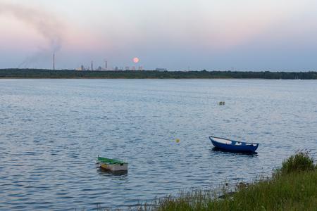 Boats on Pogoria 4 lake at moonrise, Dabrowa Gornicza, Poland