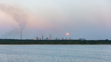 panoramic view of moonrise over the industrial zone in Dabrowa Gornicza, Poland