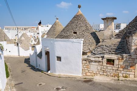 Famous trulli houses in Alerbobello town, Apulia, Italy Stock Photo