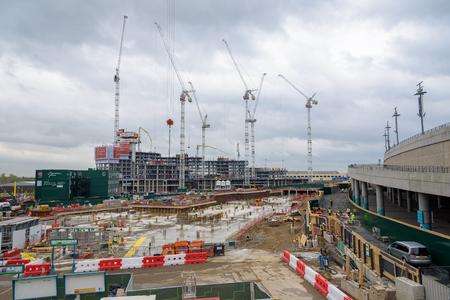 London, UK - April 27, 2018: Construction cranes erect modern complex of Wembley Park