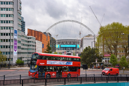 London, UK - April 27, 2018: Red double decker bus in front of the Wembley stadium on the overcast day. Editorial