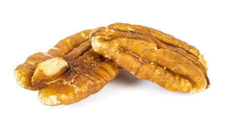 Close-up of pecan nuts isolated on white background