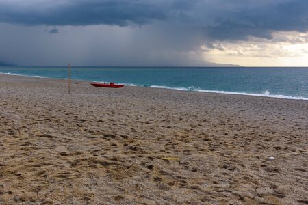 Dark clouds over the calabrian beach before the storm