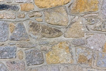 Texture or background made of old stone wall