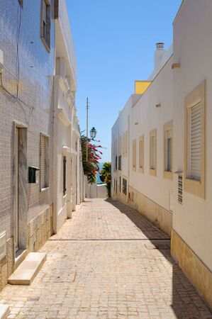 Picuresque narrow street in Albufeira, Algarve, Portugal Stock Photo