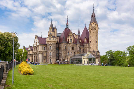 Moszna, Poland - May 21, 2017: View of the 17th century neobaroque Moszna Castle in southwestern Poland, often featured in the list of most beautiful castles in the world