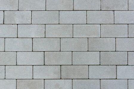 Gray sett bricks - texture or background, pavement. Imagens