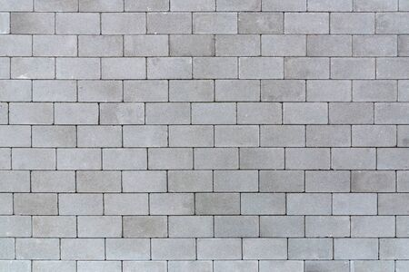Gray sett bricks - texture or background, pavement.