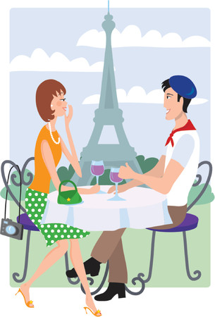 Couple sitting at a table in front of the Eiffel Tower