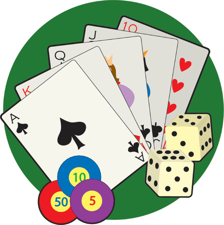 Playing cards, dice and poker chips on a green background